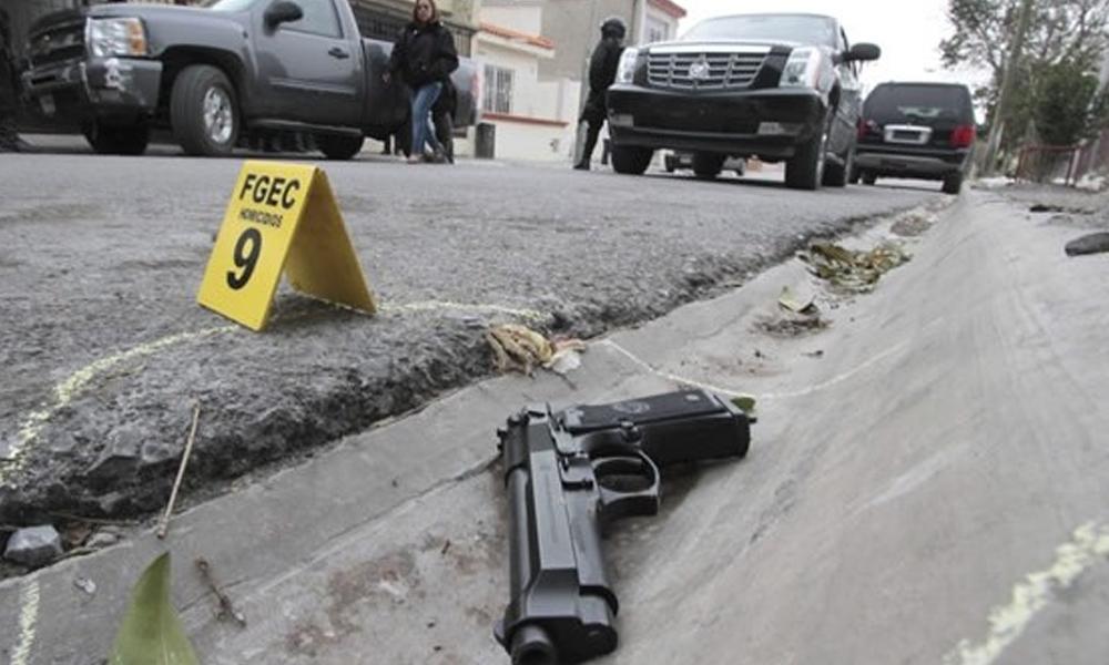violencia pistola